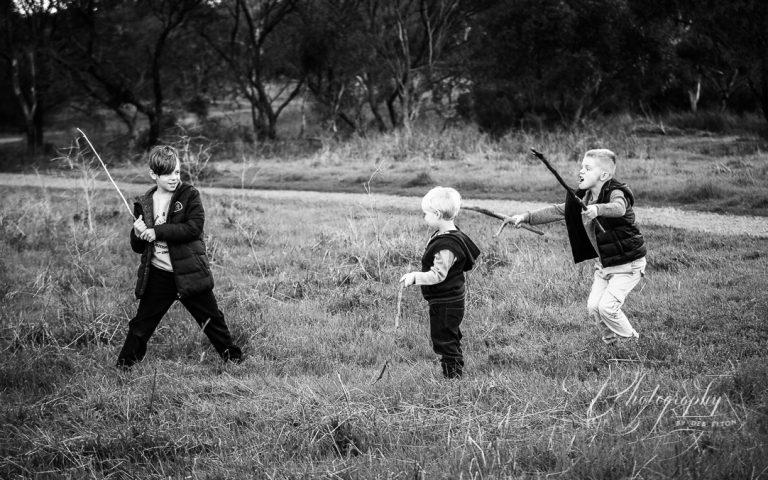 boys+playing+field+sticks