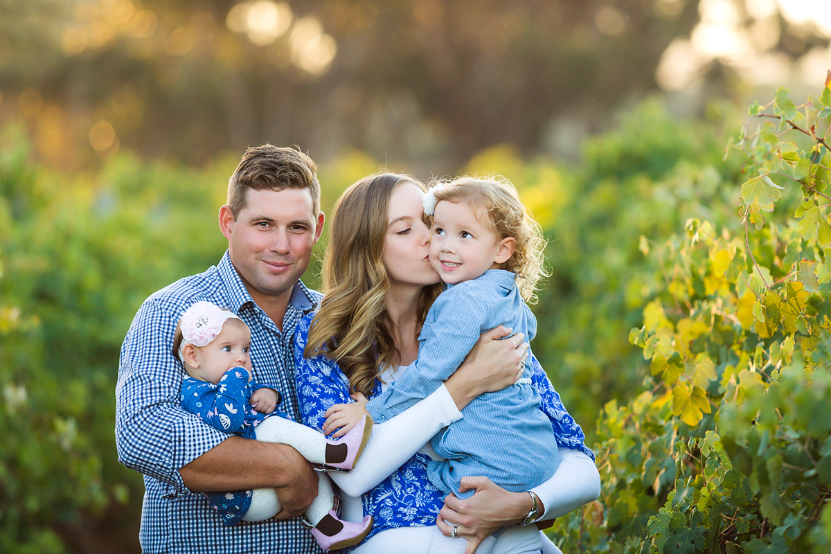 Family hugs in the vineyards family photography by deb elton photography